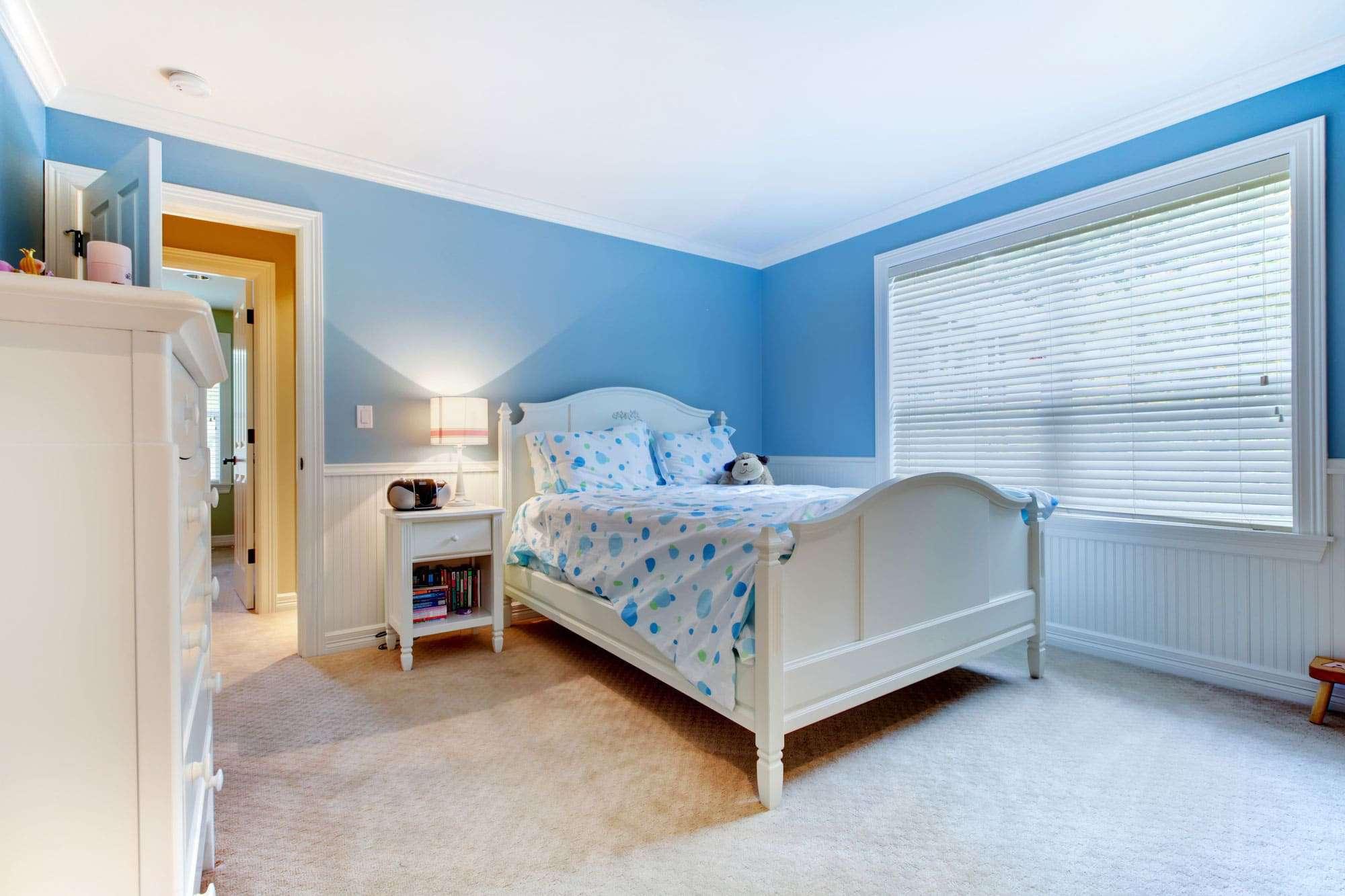 Blue girls kids bedroom interior clean carpet.