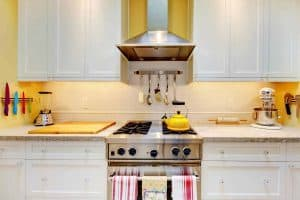 Sparking yellow and white kitchen stoves oven and countertop